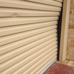 Broken Cream Colour Garage Roller Door
